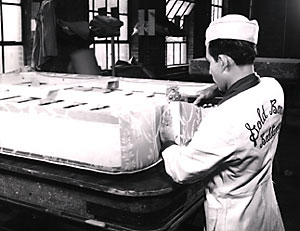 A craftsman making a Gold Bond mattress, circa 1950.